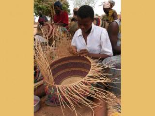 Artist weaving the African Market Baskets