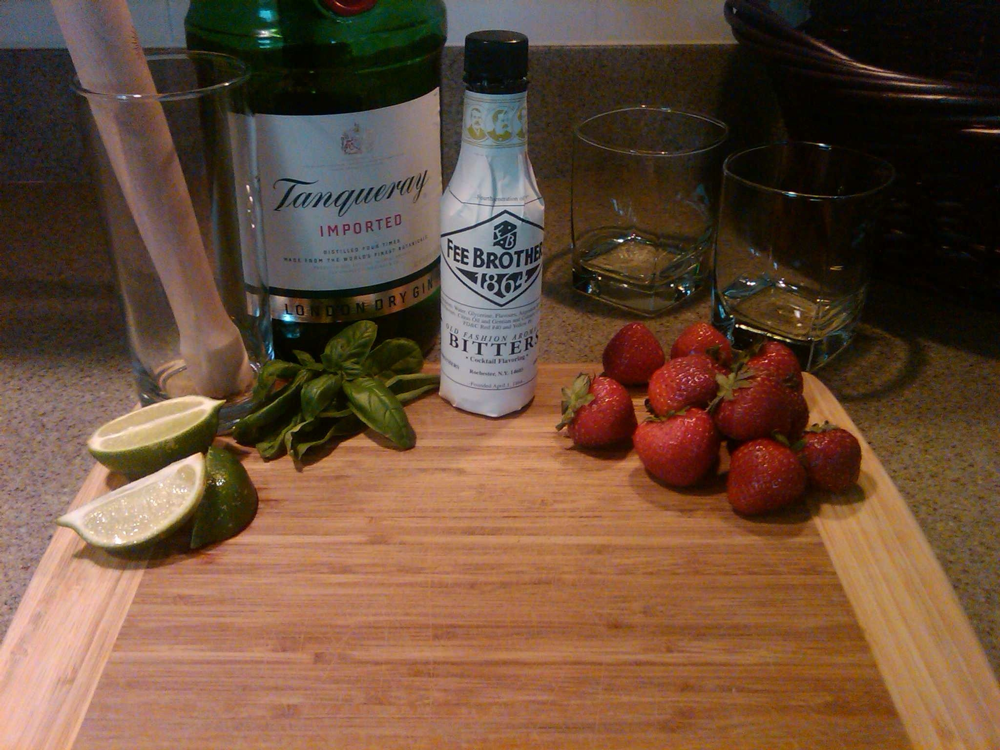 ingredients to make summer cocktail including Fee Brother's Bitters