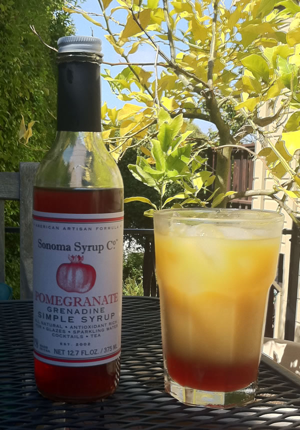 Tequila Sunrise made with Sonoma Syrup Grendine